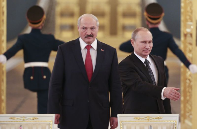 Russia's President Vladimir Putin and his Belarusian counterpart Aleksandr Lukashenko attend a session of the Supreme State Council of the Union State at the Kremlin in Moscow on March 3, 2015.