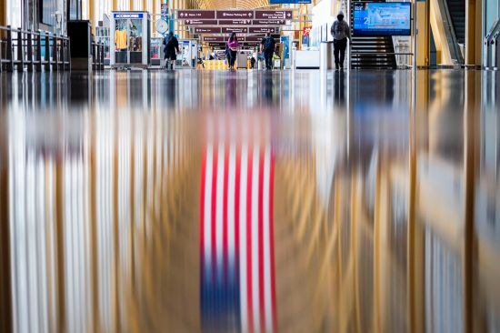 Passengers walk through an empty Reagan National Airport in Arlington, Virginia, on May 12.