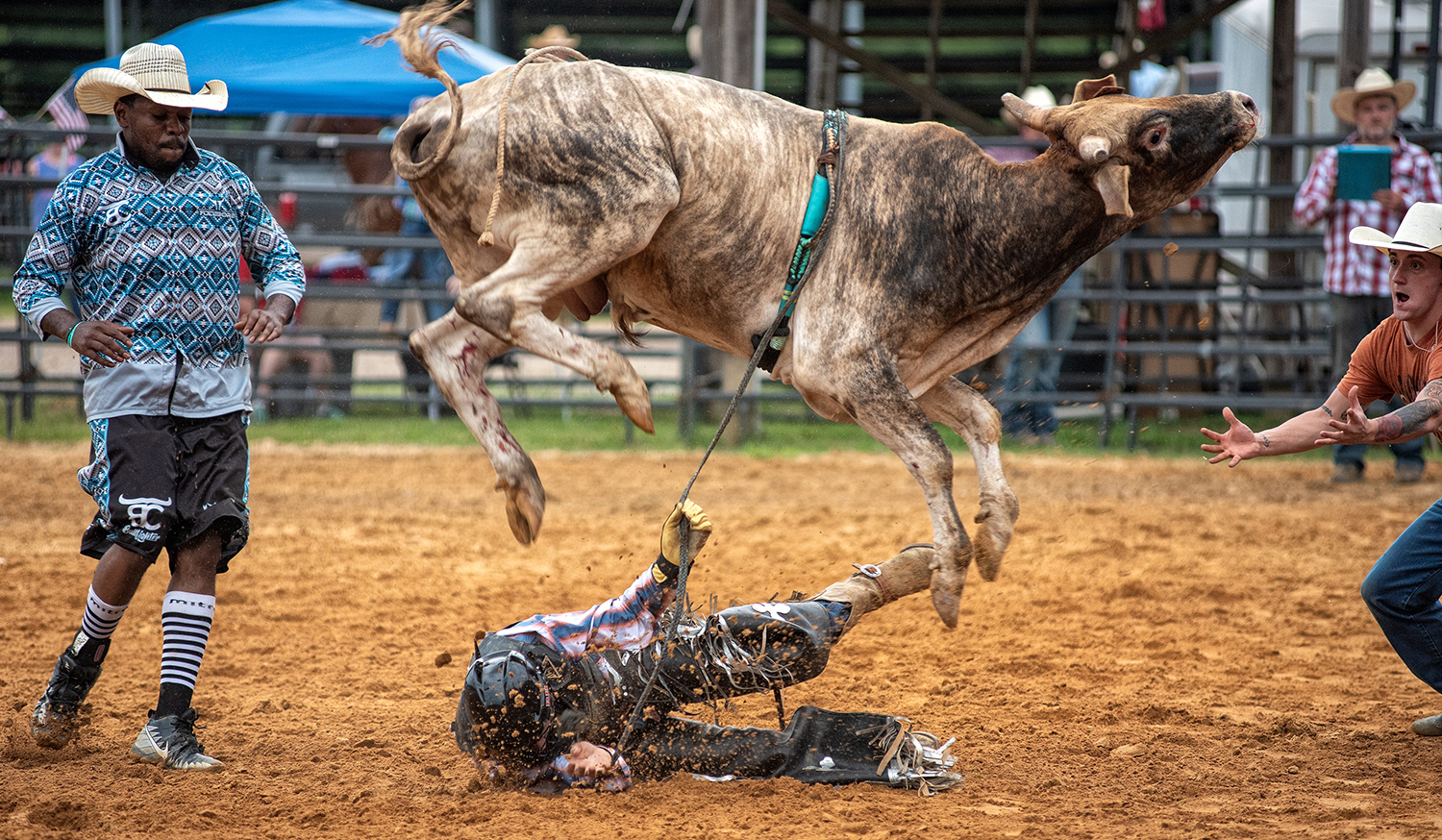 A bull throws its rider during the God and Country Rodeo held at Hayseed Cowboy Church in Thaxton, Mississippi, on July 4. Timothy Ivy/Getty Images
