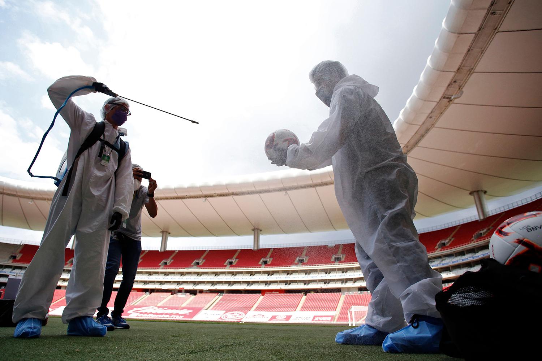 Amid the coronavirus pandemic, footballs are sanitized before the Copa por Mexico preseason football tournament match at Akron Stadium in Zapopan, Guadalajara, in Mexico on July 12, 2020 ULISES RUIZ/AFP via Getty Images)
