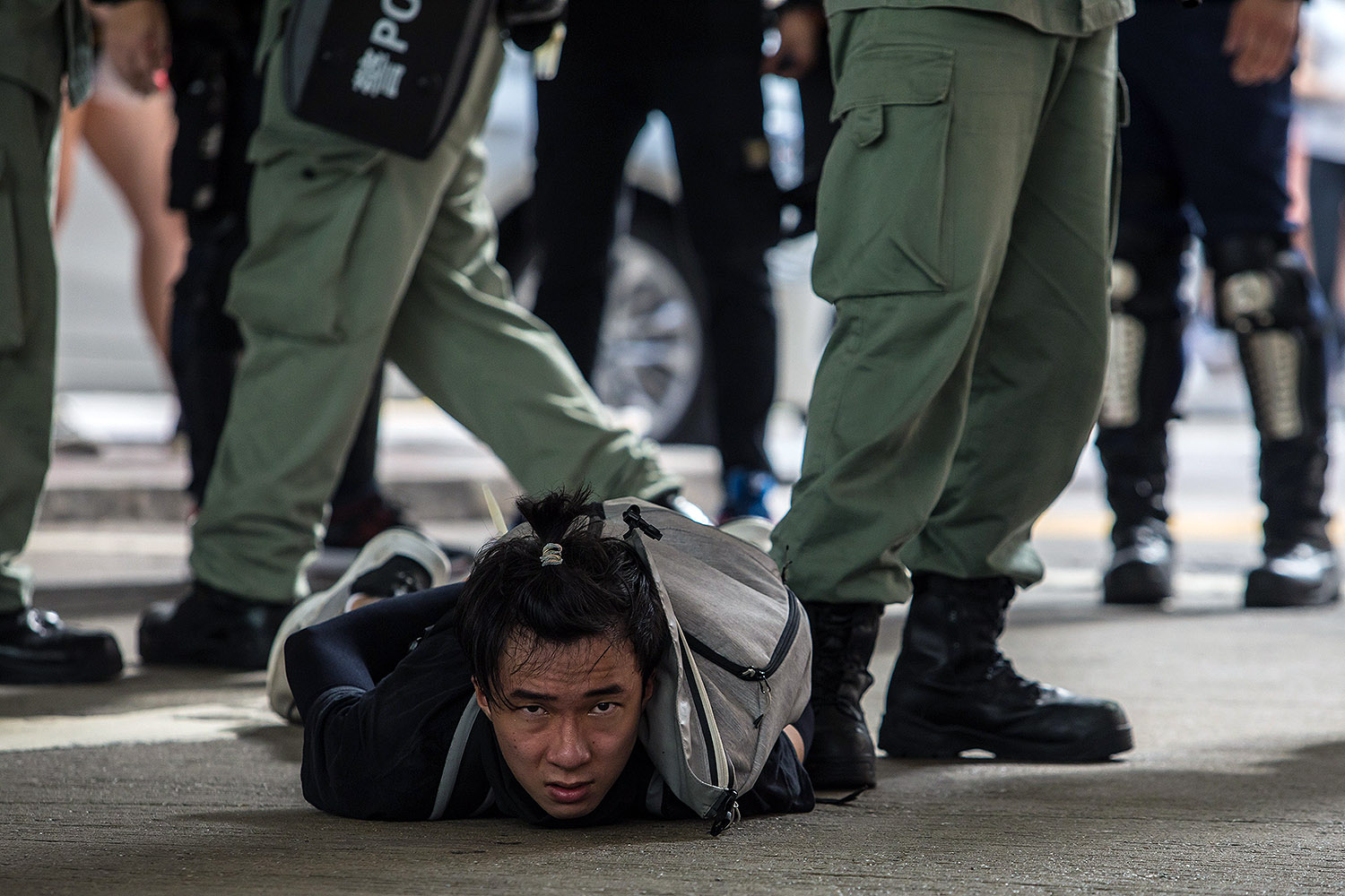 On the 23rd anniversary of Hong Kong's handover from Britain to China, Hong Kong riot police make the first arrests under Beijing's new national security law July 1. DALE DE LA REY/AFP via Getty Images
