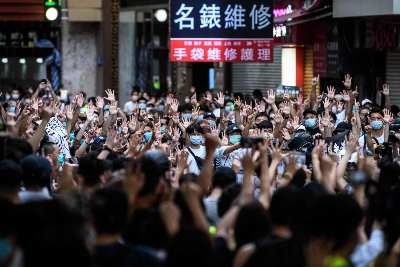 Protesters chant slogans and gesture during a rally against China's new national security law in Hong Kong on July 1, 2020.