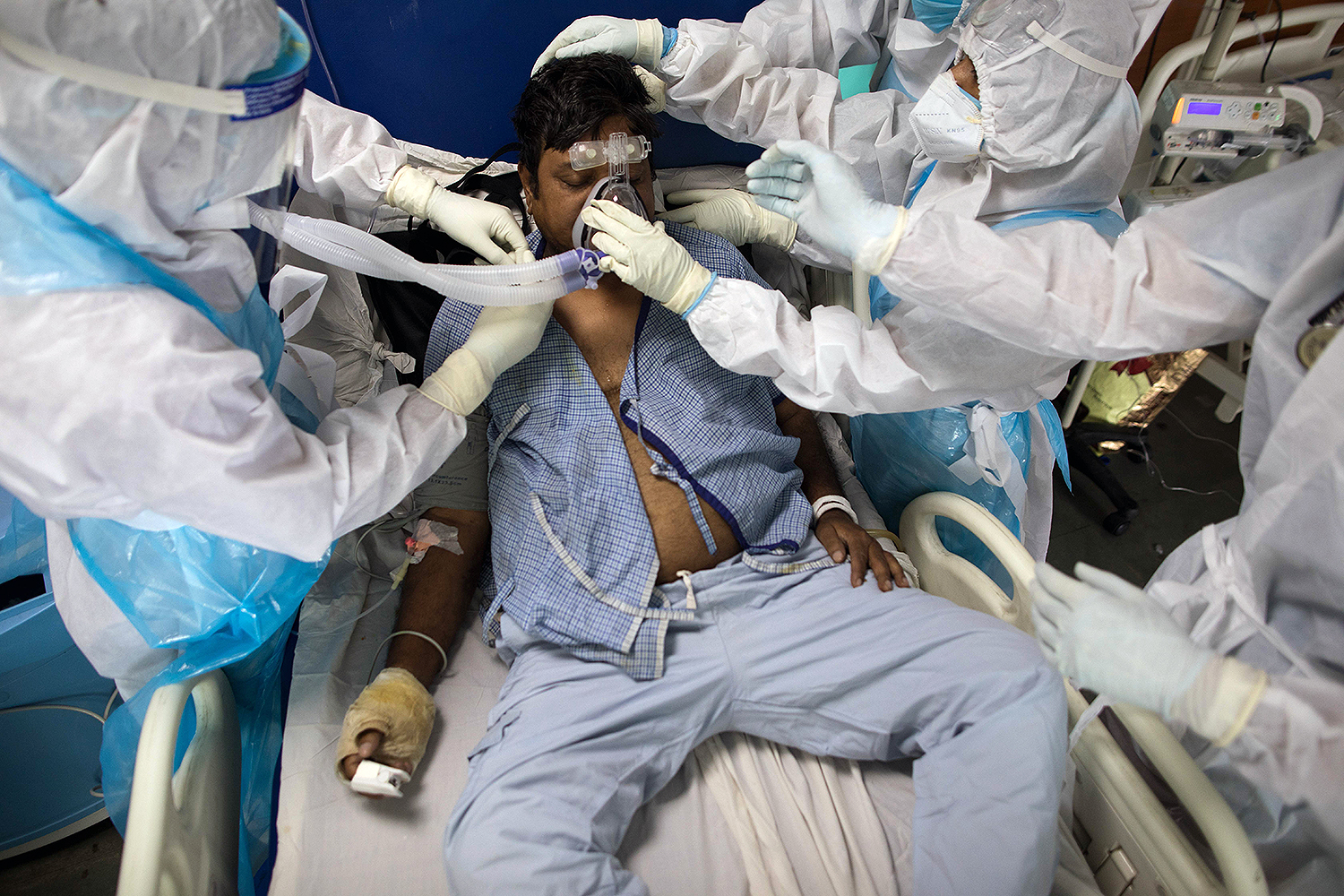 Doctors and nurses take care of a COVID-19 patient in the Intensive Care Unit of Sharda Hospital in Greater Noida, India, on July 15. XAVIER GALIANA/AFP via Getty Images