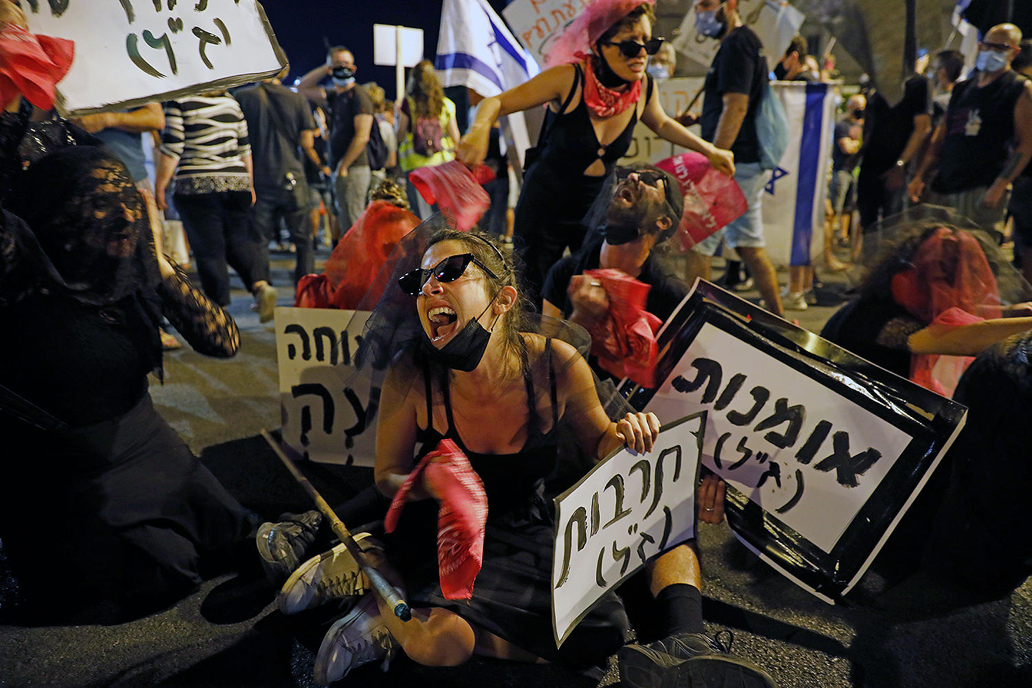 Israelis protest against Prime Minister Benjamin Netanyahu in Jerusalem on July 30. Protests have grown against the veteran premier over his handling of the coronavirus pandemic and the resulting economic crisis. AHMAD GHARABLI/AFP via Getty Images