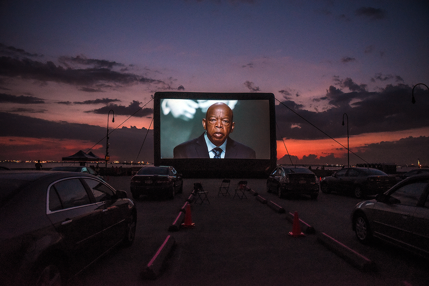 "Just hours before his death was announced, an image of U.S. Rep. John Lewis appears during a screening of the documentary ""John Lewis: Good Trouble"" at the Brooklyn Army Terminal in New York on July 17. Stephanie Keith/Getty Images"