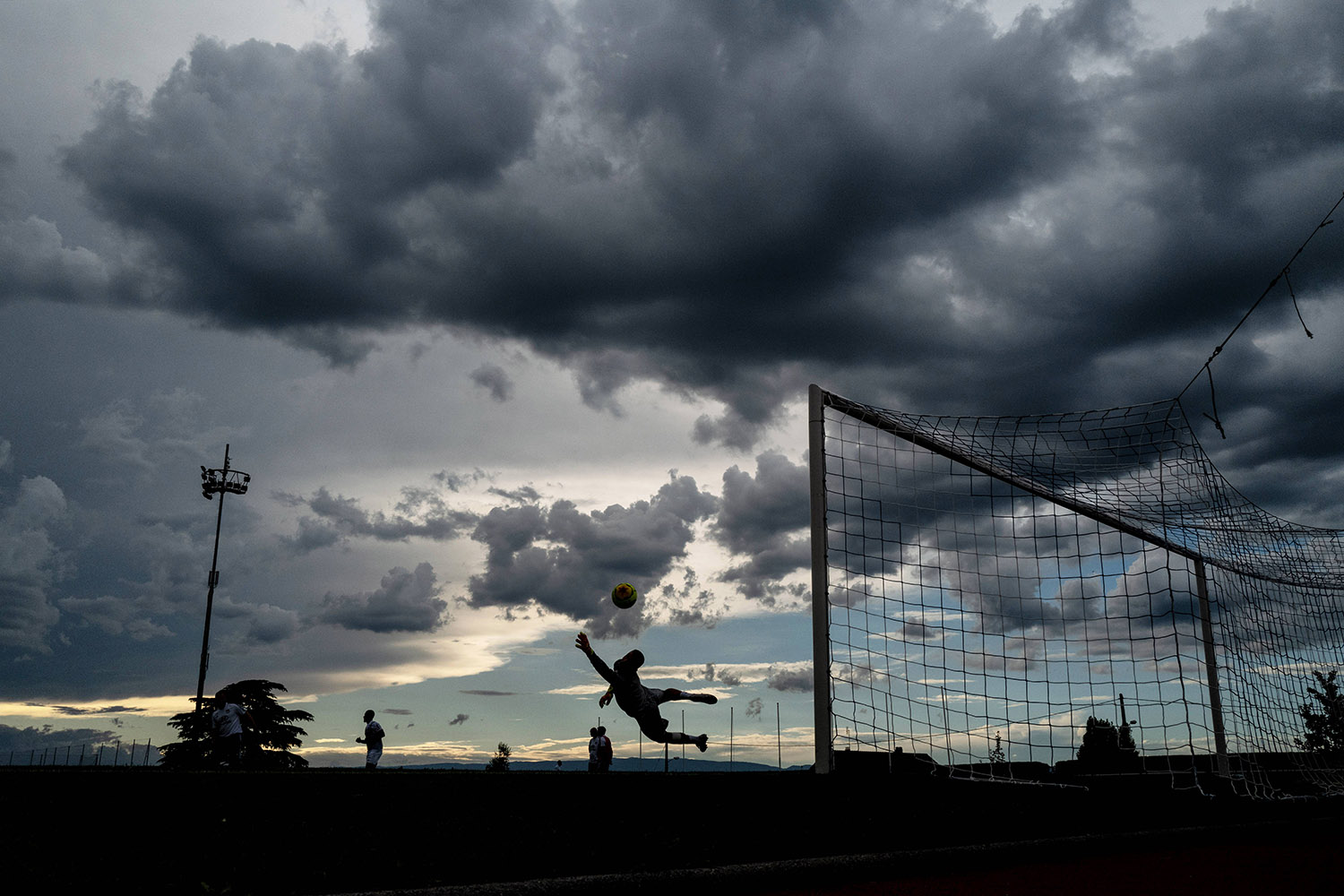Olympique Lyonnais's Portuguese goalkeeper Anthony Lopes warms up prior to the start of a match between Lyon and U.S. Port-Valais in Évian-les-Bains, France, on July 1. JEFF PACHOUD/AFP via Getty Images