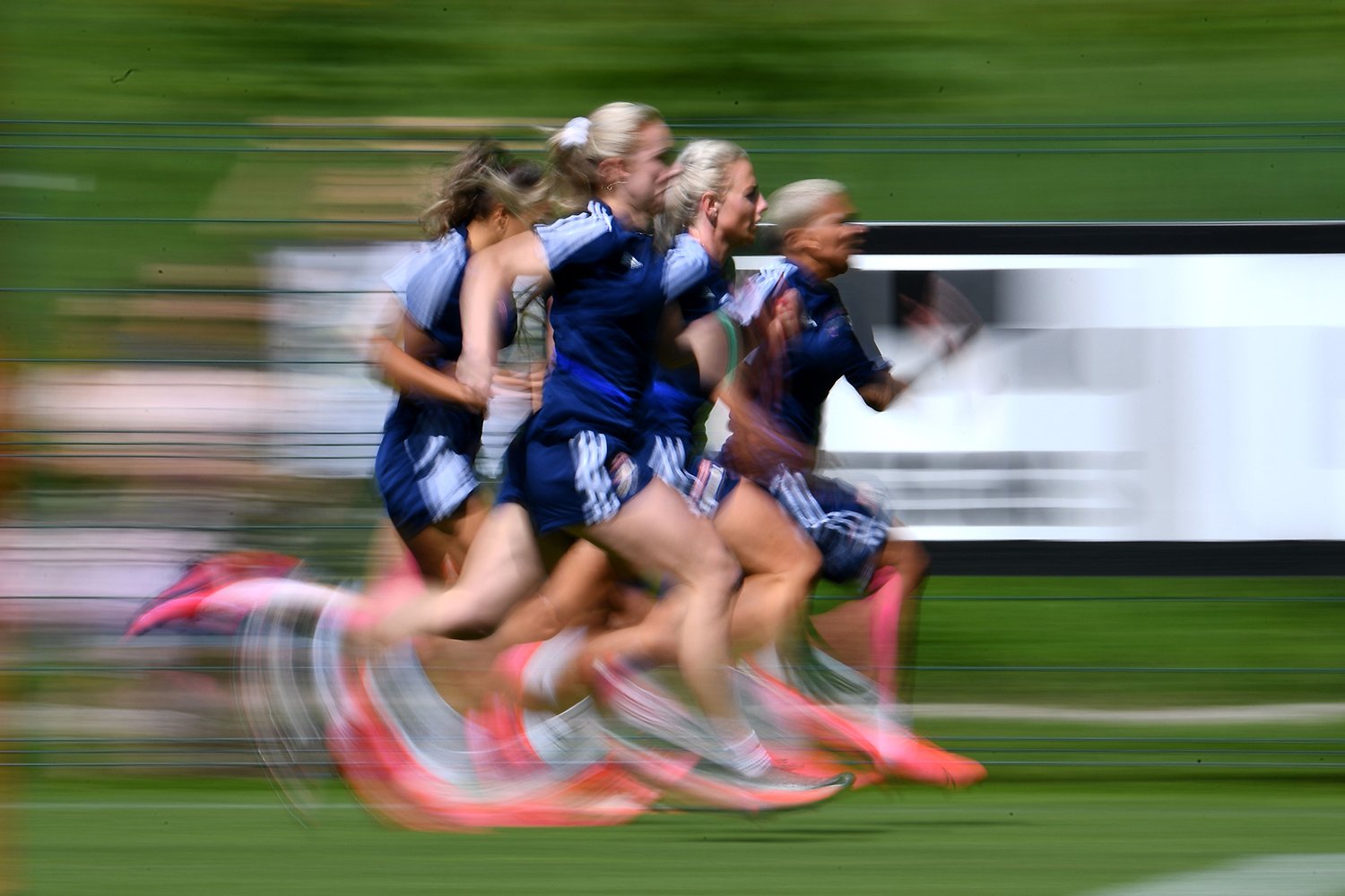 Members of the Olympique Lyonnais women's football club sprint during a training session at the Cantona stadium in Tignes, French Alps, on July 6. FRANCK FIFE/AFP via Getty Images