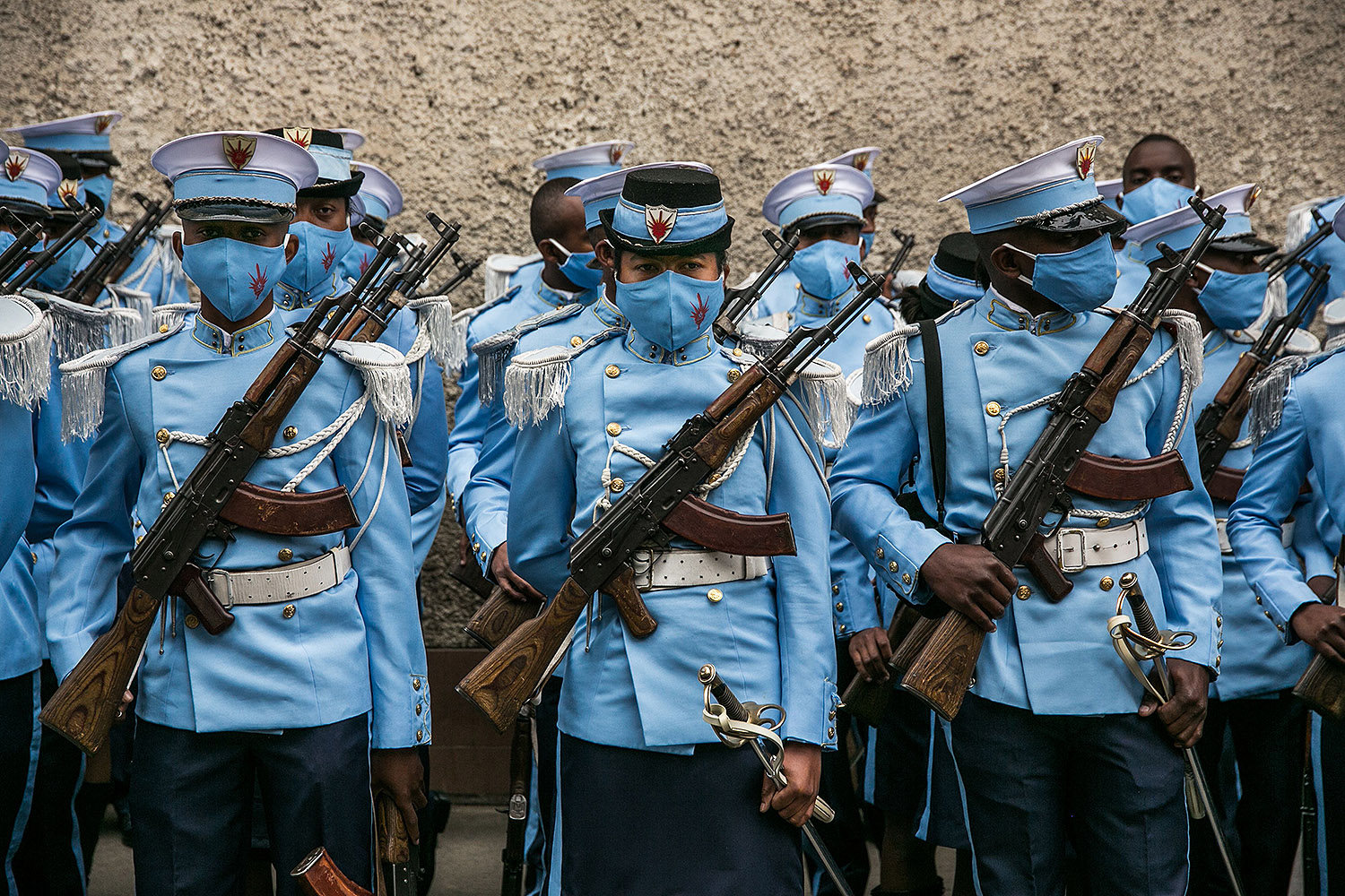 Students from the Antsi Military Academy are positioned in downtown Antananarivo, Madagascar, on June 26 before an Independence Day military parade. RIJASOLO/AFP via Getty Images