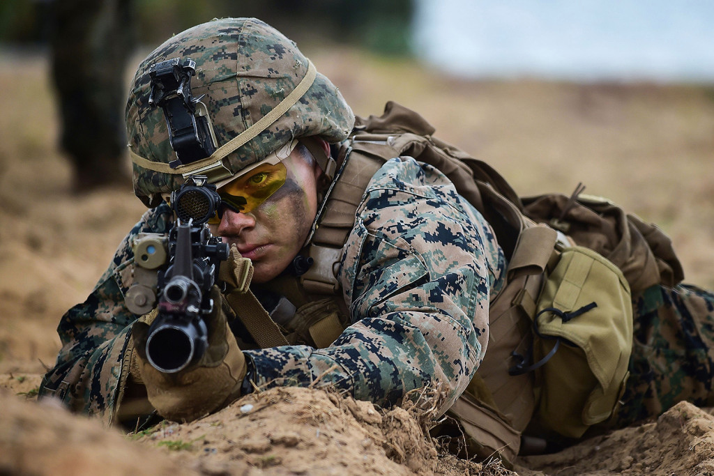 A U.S. Marine takes position