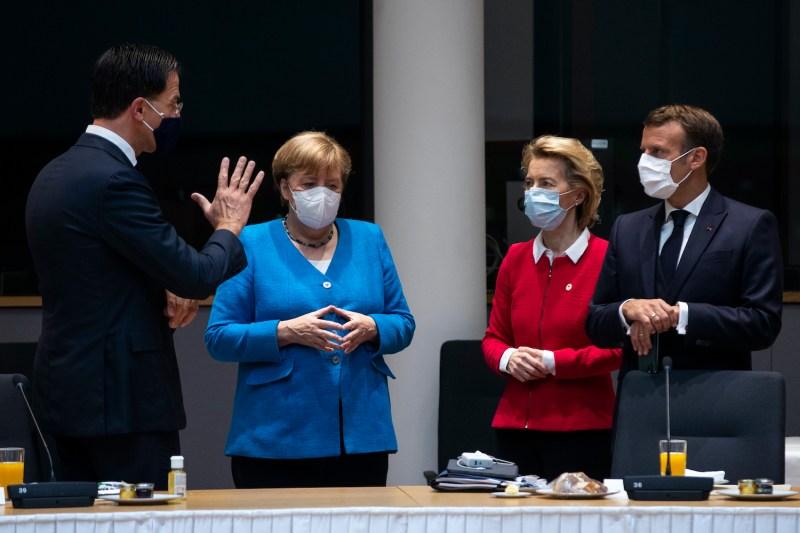 Dutch Prime Minister Mark Rutte, German Chancellor Angela Merkel, European Commission President Ursula von der Leyen and French President Emmanuel Macron speak together ahead of an EU summit at the European Council building in Brussels, on July 18, 2020.