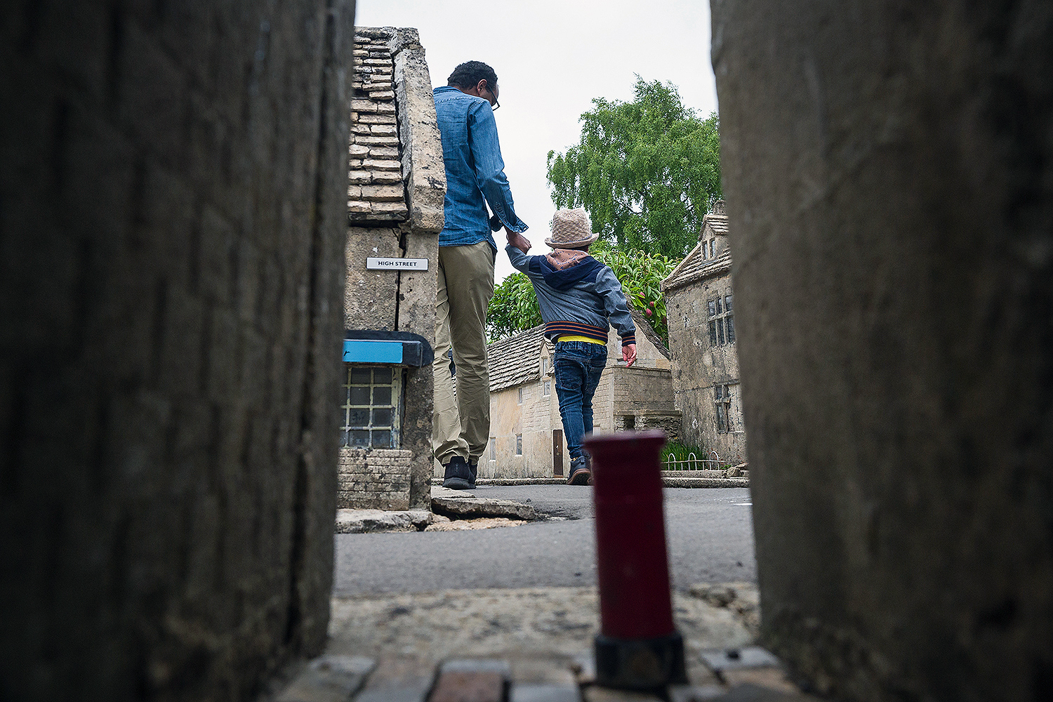 A father and son walk along one of the miniature streets of the model village in Bourton-on-the-Water, England, on July 4. Leon Neal/Getty Images