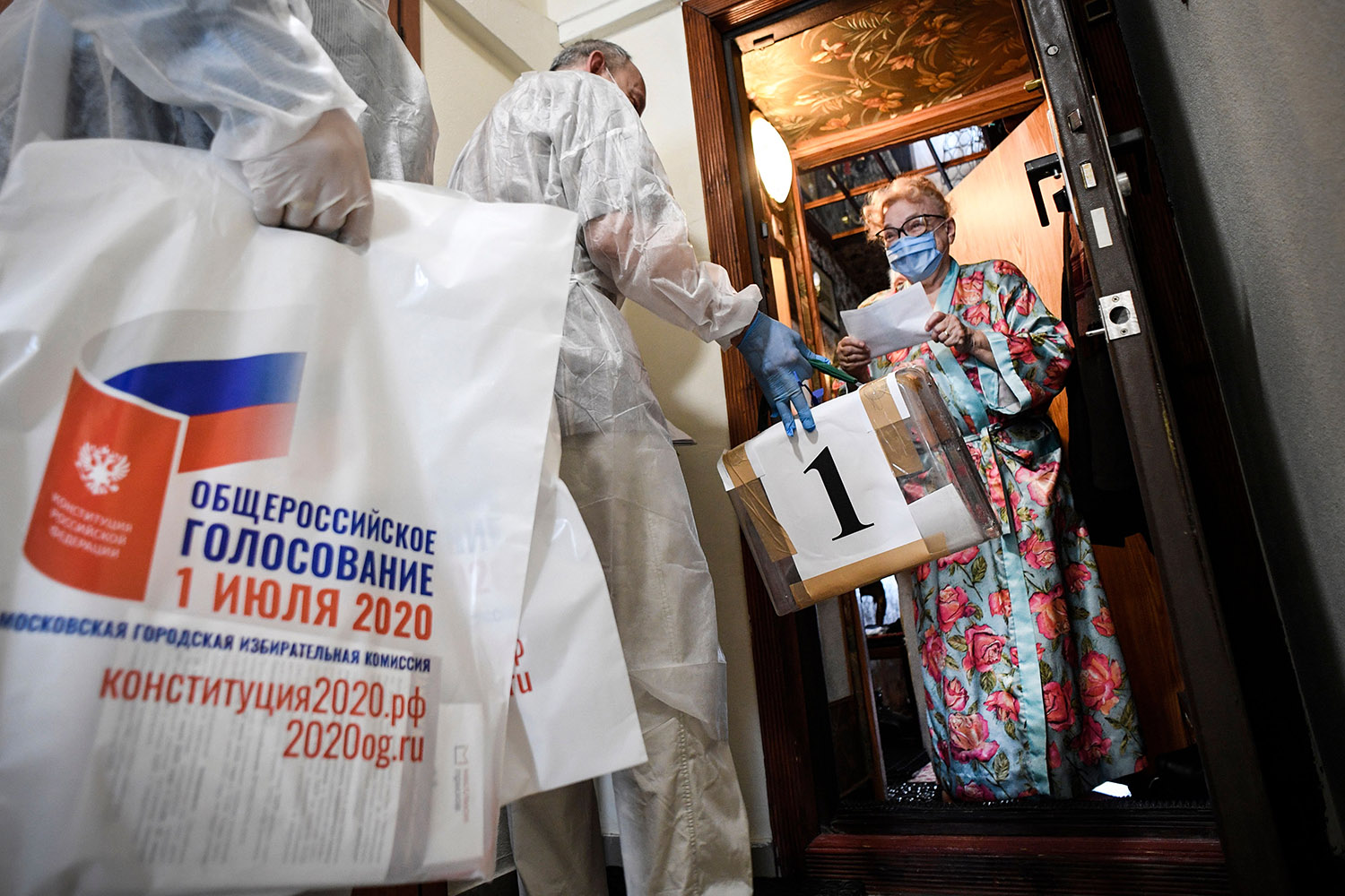 A mobile ballot box is bought to the home of a voter in Moscow on July 1, part of an effort to help Russians vote on constitutional reforms amid the coronavirus pandemic. ALEXANDER NEMENOV/AFP via Getty Images