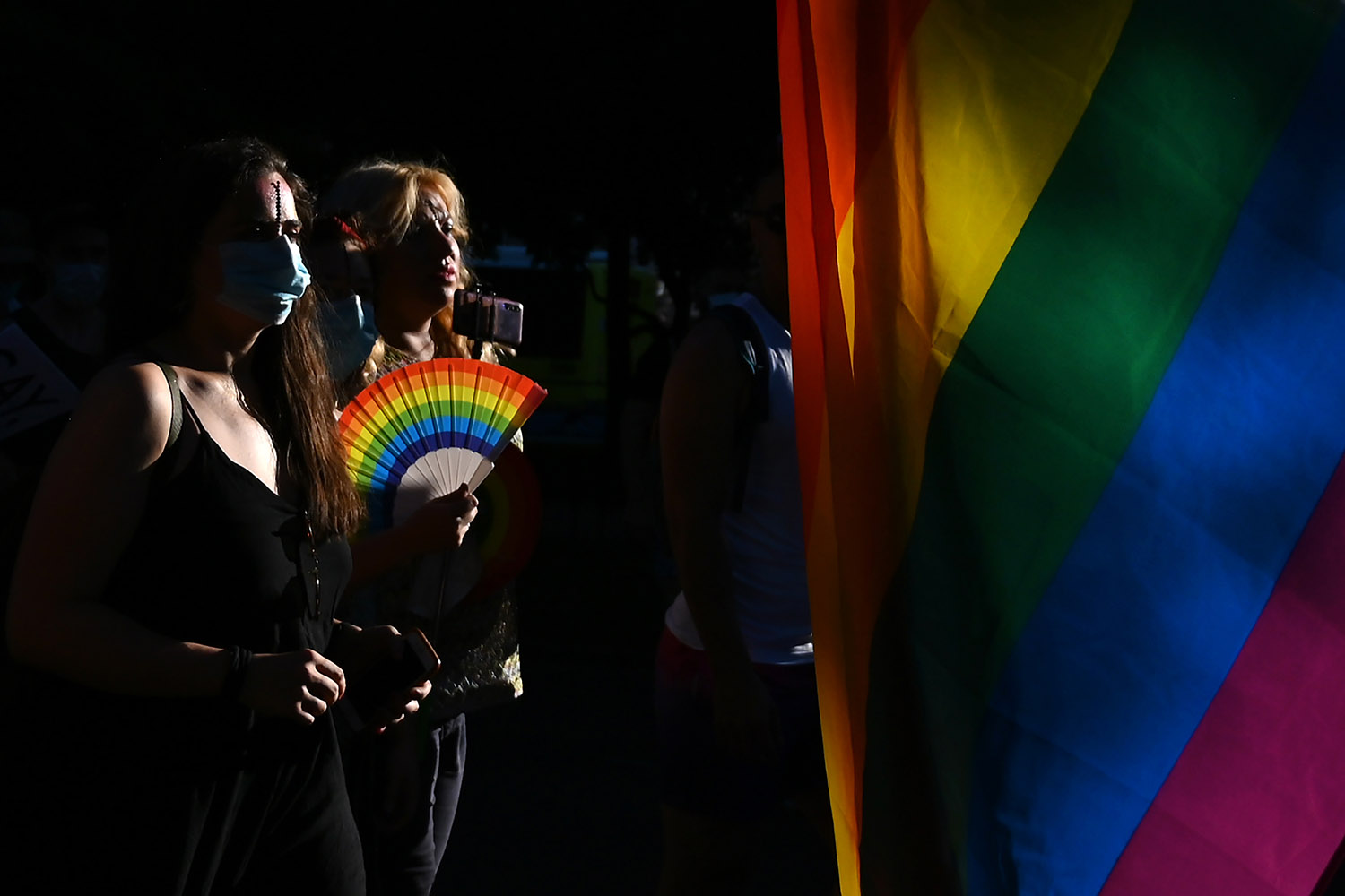 Demonstrators march with a rainbow flag during the 2020 Critical Pride parade in Madrid on June 28. GABRIEL BOUYS/AFP via Getty Images
