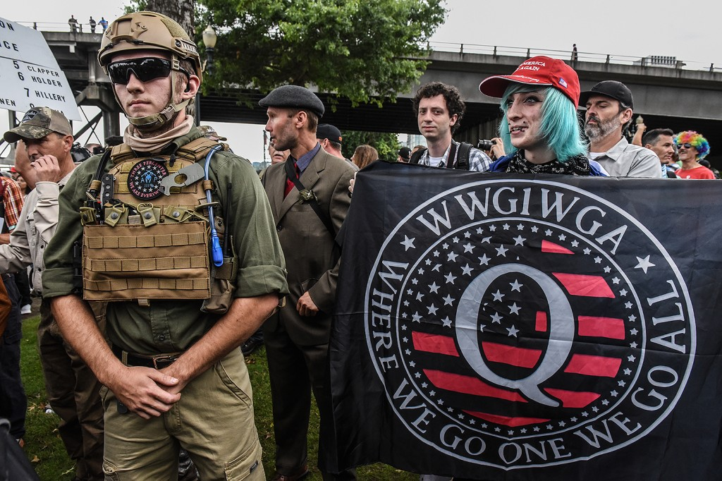 A demonstrator holds a banner referring to the QAnon conspiracy theory during an alt-right rally in Portland, Oregon, on Aug. 17, 2019.