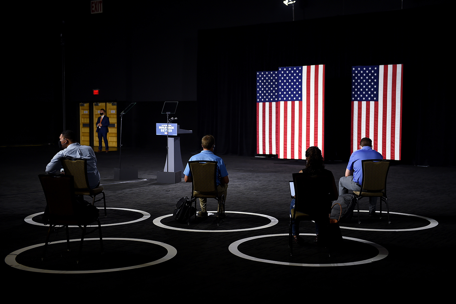 Socially distanced reporters wait for Democratic presidential candidate Joe Biden at a campaign event in Wilmington, Delaware, on July 14. OLIVIER DOULIERY/AFP via Getty Images