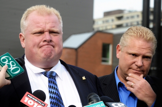 Doug Ford (right) stands next to his brother Rob Ford, the mayor-elect of Toronto, as he speaks to the media at Don Bosco Catholic Secondary School, where the latter was a football coach, on Oct. 26, 2010.