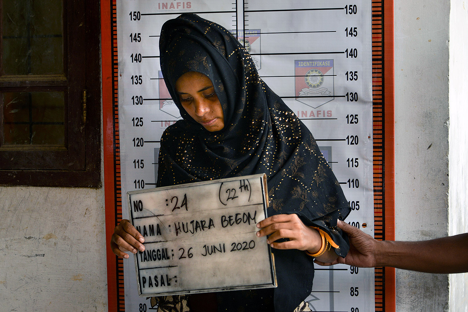 A Rohingya woman from Myanmar goes through an identification procedure by Indonesian police at the immigration detention center in Lhokseumawe, Sumatra, on June 26. CHAIDEER MAHYUDDIN/AFP via Getty Images