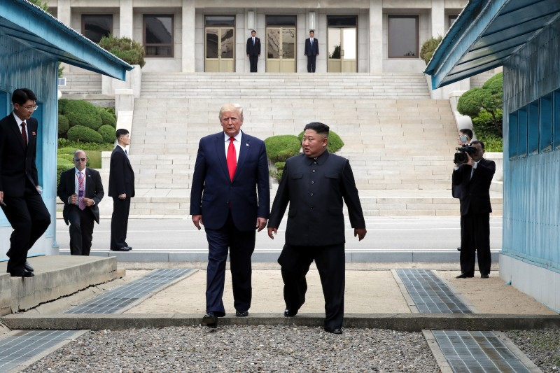 U.S. President Trump meets with North Korean leader Kim Jong-un at the demilitarized zone separating South and North Korea on July 30, 2019.