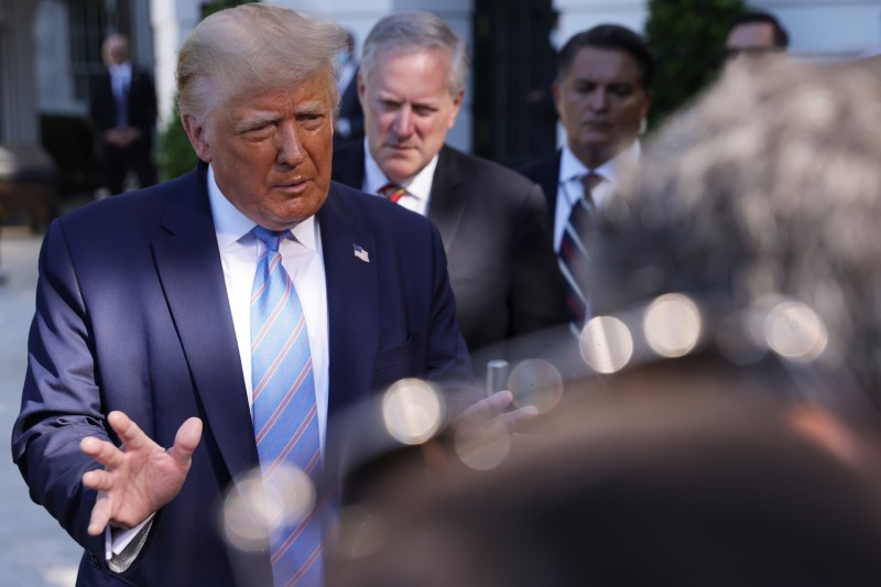 U.S. President Donald Trump speaks as White House Chief of Staff Mark Meadows  listens prior to Trump's Marine One departure from the South Lawn of the White House July 29, 2020 in Washington, D.C.