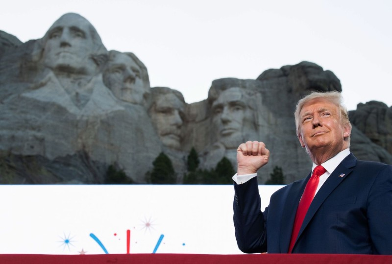 U.S. President Donald Trump pumps his fist as he arrives for an Independence Day event at the Mount Rushmore National Memorial in Keystone, South Dakota on July 3, 2020.