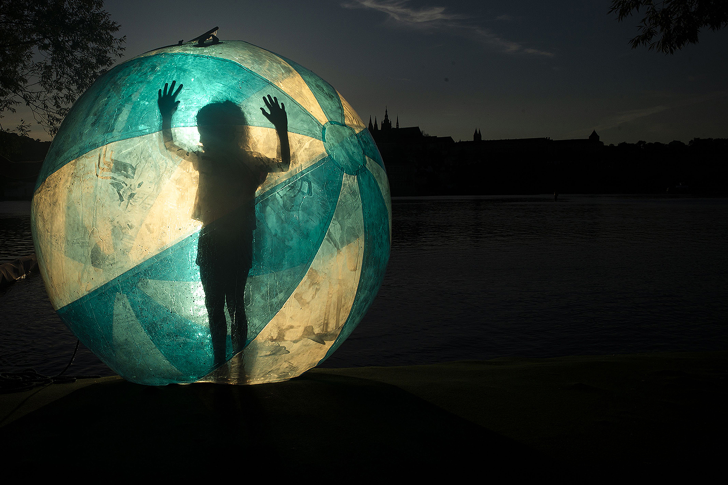 A tourist stands inside a zorb ball on the banks of Vltava River in Prague on July 13. MICHAL CIZEK/AFP via Getty Images