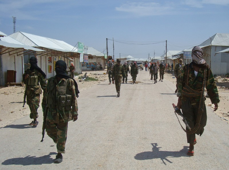 Al-Qaeda linked al-Shabab recruits walk down a street on March 5, 2012 in the Deniile district of Somalian capital, Mogadishu, following their graduation.