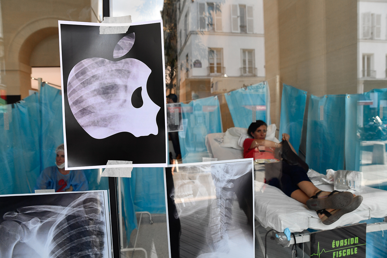 Activists set up a faux hospital in the Apple Store in Saint-Germain near Paris, France, on June 30, 2018, in protest of Apple's tax evasion and government inaction on tax havens and health care funding.