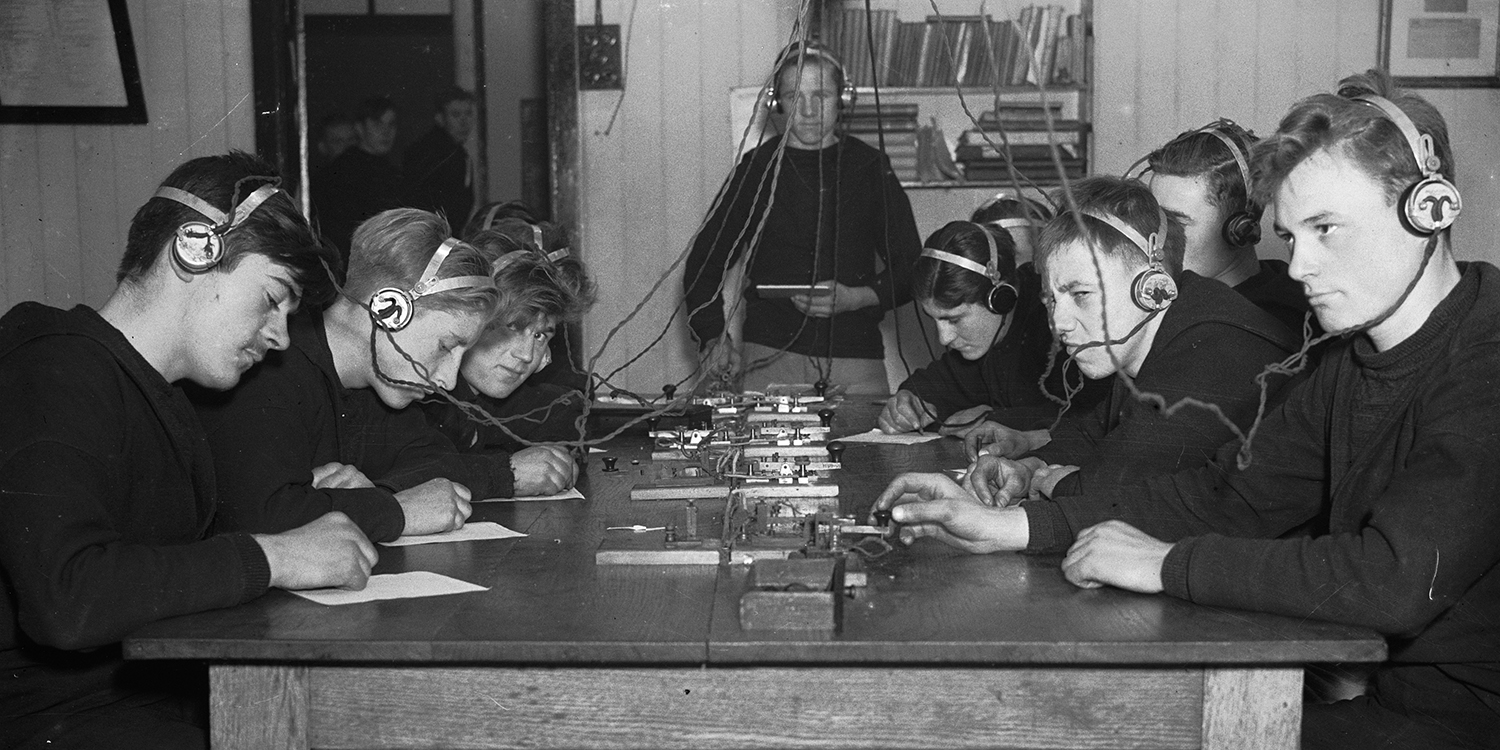 British cadets practice Morse code on one of the model ships built for training at the Nautical Training School at Heswall, Cheshire, on Dec. 3, 1936.