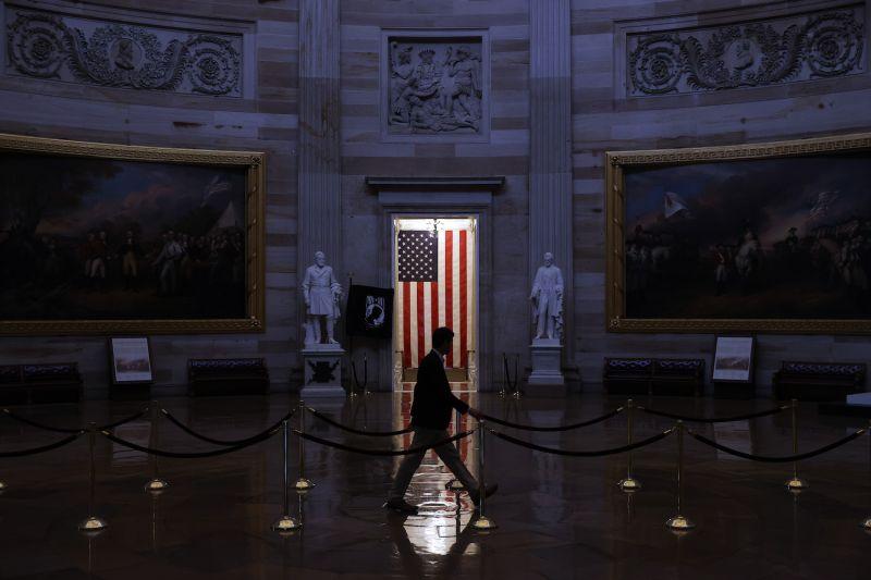 A man walks through the U.S. Capitol Rotunda