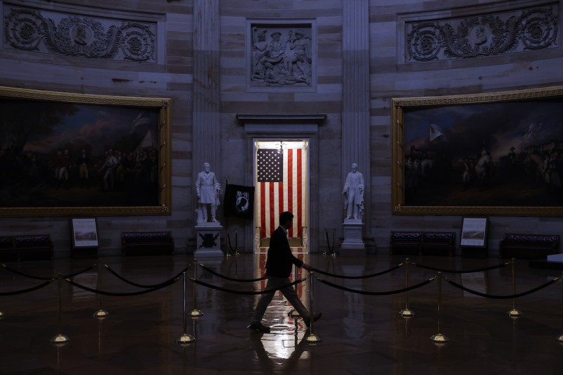 A man walks through the U.S. Capitol Rotunda
