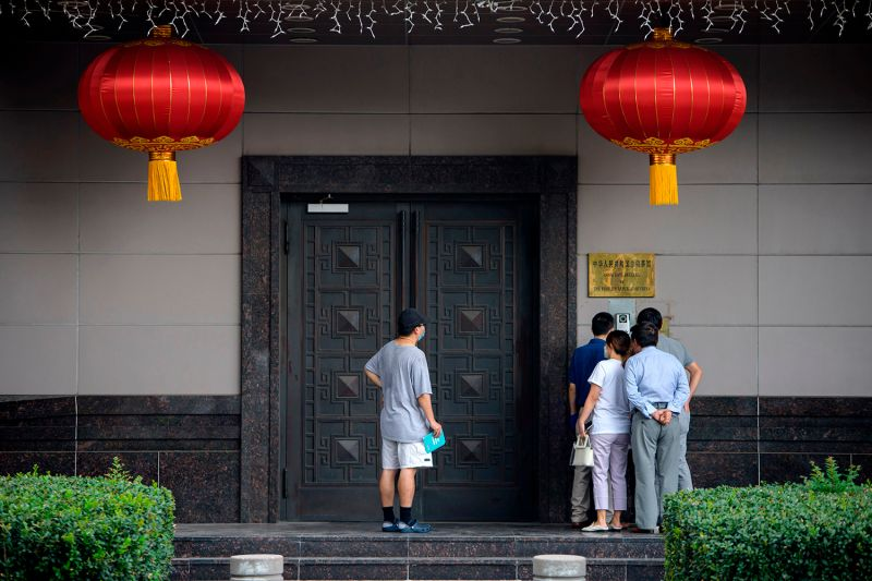 People attempt to speak to someone at the Chinese consulate in Houston on July 22.