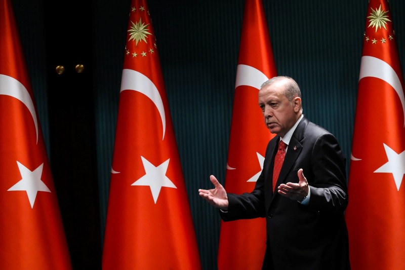 Turkish President Recep Tayyip Erdogan arrives on stage to deliver a speech following a cabinet meeting in Ankara on June 9.