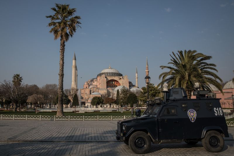 A police van patrols in front of Hagia Sophia during a two-day lockdown imposed prevent the spread of COVID-19 on April 11,  in Istanbul, Turkey.