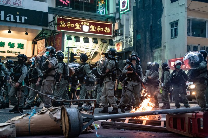 Riot police secure an area in front of a road block during a demonstration against the new national security law on July 1 in Hong Kong.