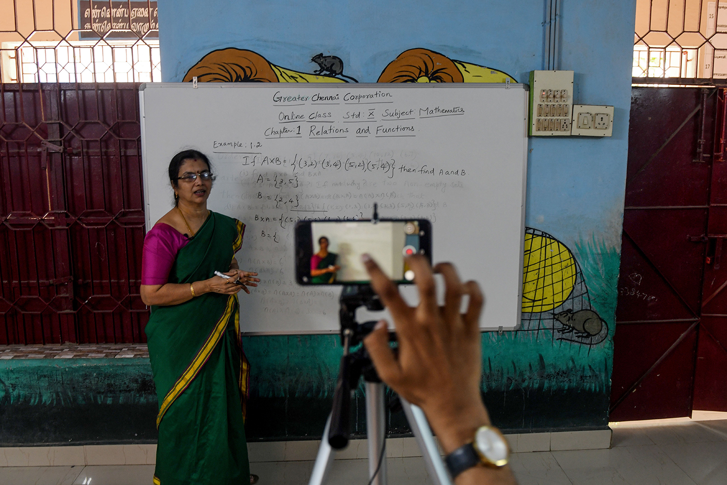 A teacher gives a live-streaming online class at a government school in Chennai on June 3.