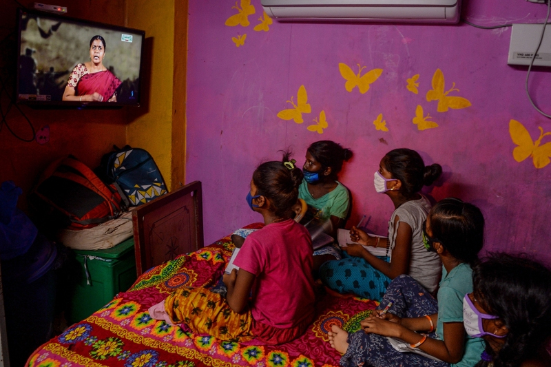 Children attend a telelearning class displayed on Kalvi TV channel, an education initiative set up by the Department of School Education to allow students to continue their curriculums as schools remain closed, at their home in Chennai, India, on July 15.