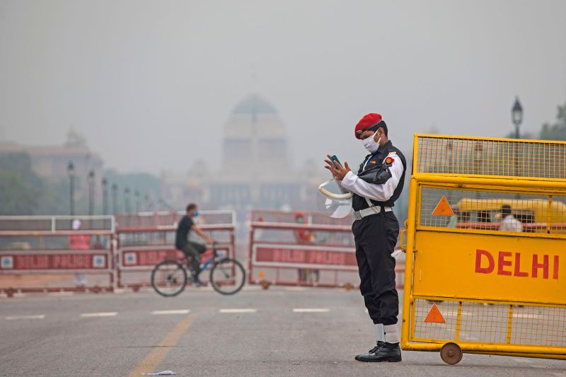 A military policeman checks his mobile phone while on duty at Rajpath road in New Delhi on July 22, 2020.
