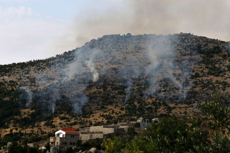Smoke billows above the edges of southern Lebanon's Kfarchouba village after reported Israeli bombardment of the Shebaa Farms sector following reports of clashes in the Lebanese-Israeli border area, on July 27, 2020.