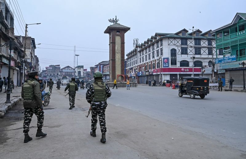 Security personnel patrol  in Srinagar on February 11, during a one-day strike to mark the anniversary of Jammu and Kashmir Liberation Front (JKLF) founder Maqbool Bhat's death.