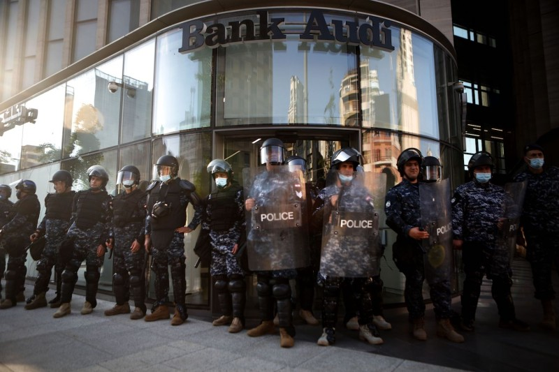 Lebanese riot police guard a bank in Beirut on April 28.
