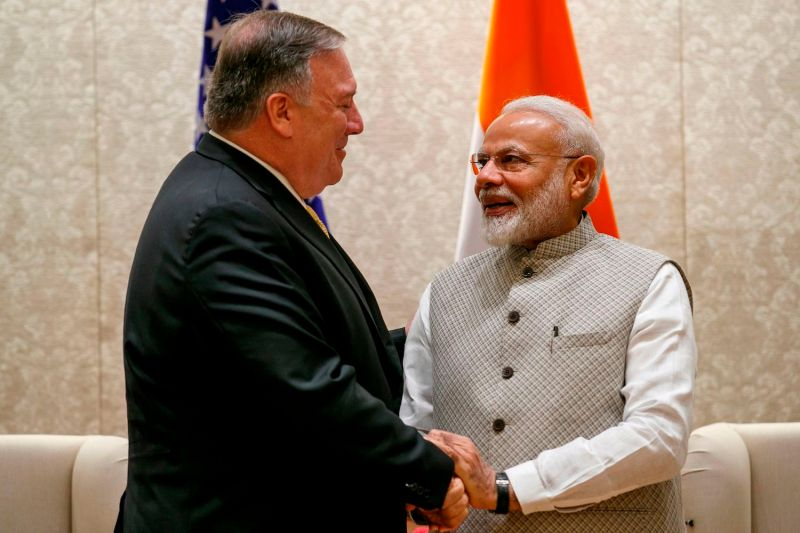 U.S. Secretary of State Mike Pompeo shakes hands with Indian Prime Minister Narendra Modi during their meeting at the prime minister's residence in New Delhi, India, on June 26, 2019.