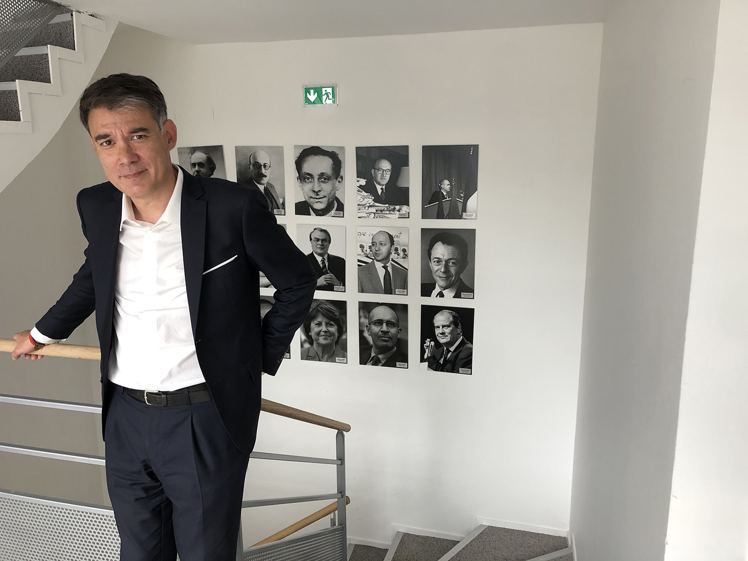 Olivier Faure, first secretary of the Socialist Party, in front of images of past party leaders at the party's headquarters in Ivry-sur-Seine, France, on June 25.
