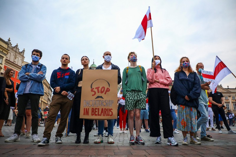 People protest at the Main Square in Krakow, Poland, during a rally of solidarity with political prisoners in Belarus on July 3.