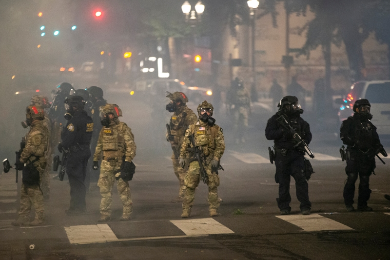 Federal officers stand guard after dispersing protesters in Portland, Oregon, on July 21.