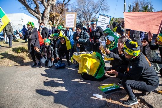 Activists and others gather outside the Roodepoort Magistrate's Court in Johannesburg on June 24.