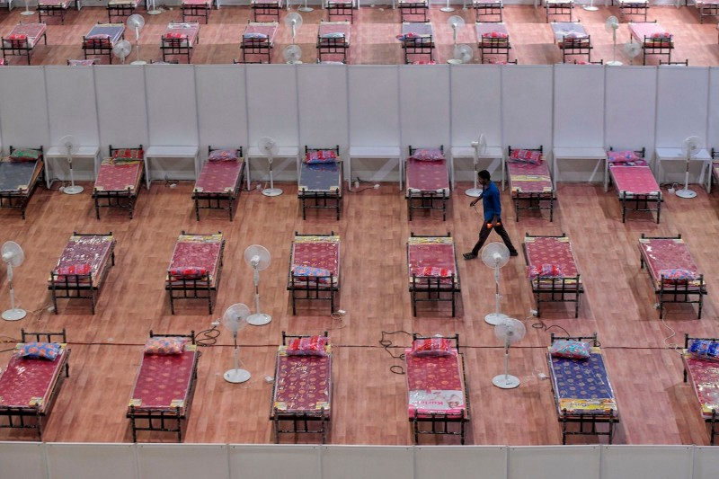 A worker walks inside a COVID Care Centre with the capacity of 10,100 beds at the Bangalore International Exhibition Centre (BIEC) to combat the COVID-19 coronavirus crisis, in Bangalore on July 7, 2020.