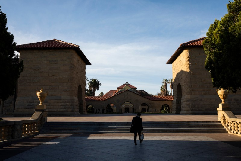 A person walks towards the main quad during a quiet morning at Stanford University on March 9, 2020 in Stanford, California.