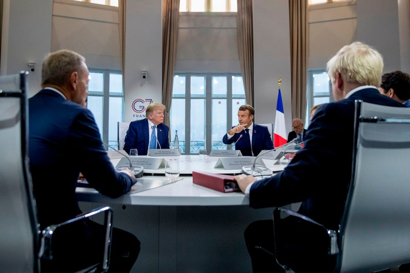 European Council President Donald Tusk, U.S. President Donald Trump, French President Emmanuel Macron, and British Prime Minister Boris Johnson attend a working session in Biarritz, France, on Aug. 25, 2019, the second day of the annual G-7 Summit.
