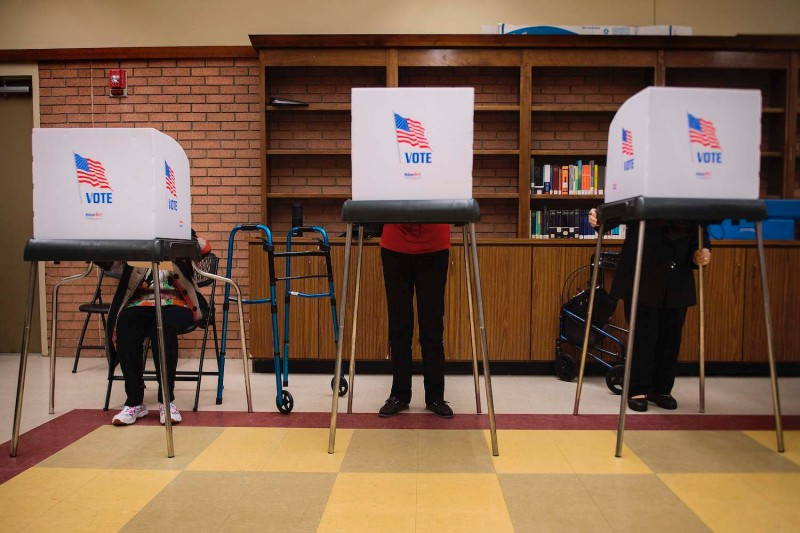 Voters in Chestertown, Maryland, cast ballots  at the Kent County Public Library in Maryland's early voting on October 25, 2018.