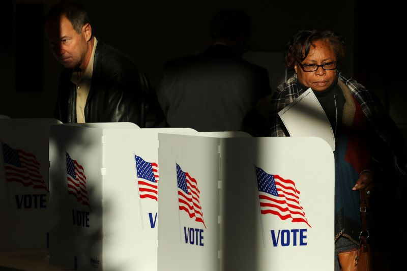 Voters cast their ballots at a polling station.